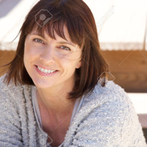 41260716-close-up-portrait-of-a-healthy-older-woman-smiling-outside-stock-photo
